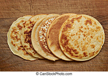 4 pancake - four round pancakes on a wooden table