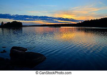 Karelian sunset. Lake Engozero, North Karelia, Russia