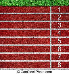 red running tracks with white start numbers at stadium...