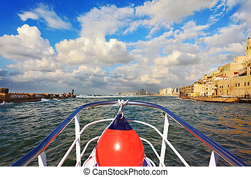 Pleasure boat on the waves - Sunset in Tel Aviv, Israel Old...