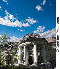 Dilapidated house with a romantic rotunda and garden terrace...