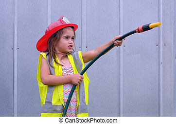 Child girl in fireman costume - Child (girl age 05) is...