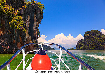 A boat trip with a red lantern. The holiday in Thailand. Bay...