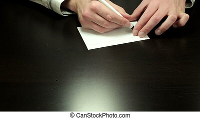 Handwriting chit How Much - Mans hands draw the chit How...