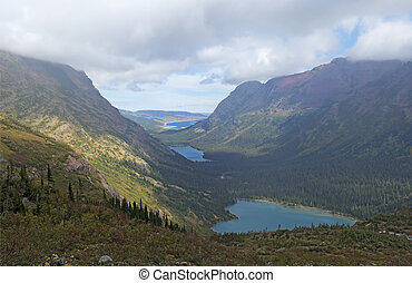 Three Lakes and Mountains Capped with Clouds - Grinnell...