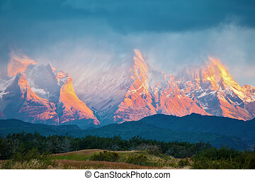 Sunrise on a windy day - National Park Torres del Paine in...