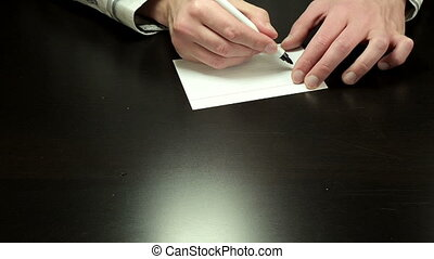 Handwriting chit One Million - Mans hands draw the chit One...