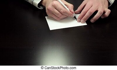 Handwriting chit Accept - Mans hands draw the chit Accept on...