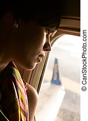 female airplane passanger enjoying the view from the cabin...