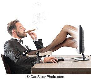 Erotic sites - Man looks erotic sites of beautiful girls