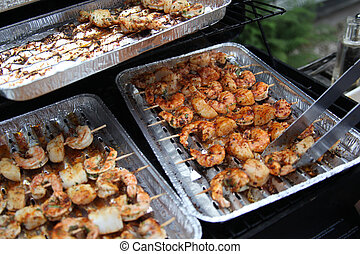 barbecue-shrimps-on-grill - several spikes of shrimps in...