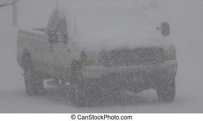 Parked Truck Snowing Hard - A view of a truck enjoying a lot...