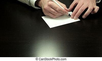 Handwriting chit Shut Up - Mans hands draw the chit Shut Up...