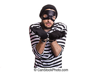 criminal, thief, robber, crime - Sad criminal with handcuffs...