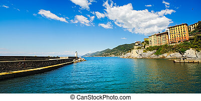 Camogli marina harbor entrance and lighthouse. Ligury, Italy...