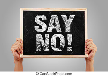 Say No blackboard is holden by hands with gray background.