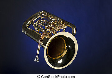 Tuba Euphonium Isolated On Blue - A gold brass euphonium...