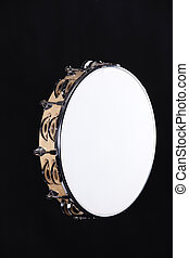 Tambourine Isolated on Black - A natural wood tambourine...