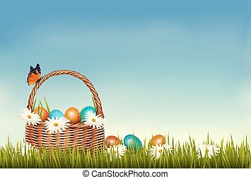 Spring Easter background. Basket with Easter eggs in grass...