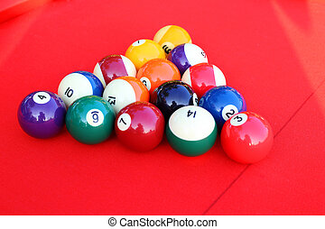 Billards pool game. Color balls in triangle on Red cloth table