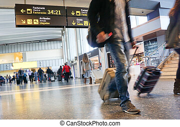 Airport -  Airline passengers inside an Airport.