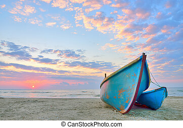 Boat on beautiful beach in sunrise on Black Sea
