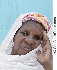 Portrait of an African woman - African woman sitting in...