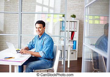 Office worker - Businessman in casualwear sitting in office