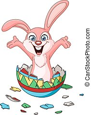 Bunny hatching from Easter egg - Happy bunny hatching from a...