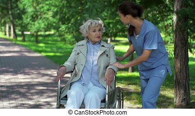 Care and Support - Static camera shot of female nurse...