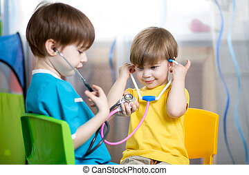 kids boys play doctor at home - kid boy weared as doctor...