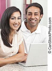 Asian Indian Man & Woman Couple Using Laptop Computer -...
