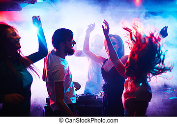 People dancing - Young people dancing in nightclub