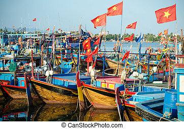 Fishing boats in marina at Nha Trang, Vietnam - several...