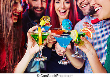 Martini hysteria - Young people clinking their cocktails