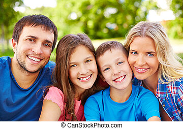 Happiness - Happy young parents with two children