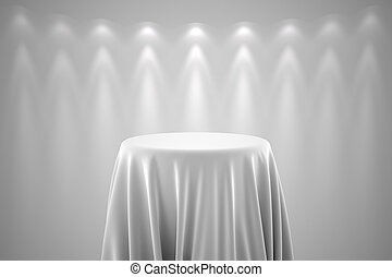 Round pedestal with white silk cloth and spot lights