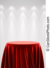 Round pedestal with red silk and spot light