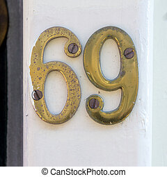 Number 69 - Gold colored house number sixty nine