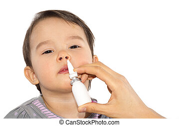 Parent's hand of a sick little girl applies a nasal spray