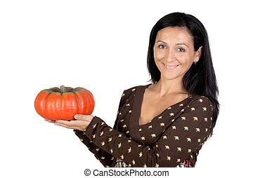 Attractive girl with a big pumpkin isolated on white...