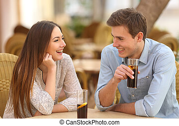 Couple or friends talking in a restaurant - Happy couple or...