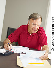 Senior man checking home finances Copy space