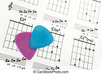 Guitar picks on a chords chart - Two colorful guitar picks...