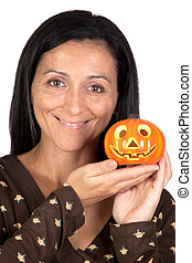 Attractive girl with a pumpkin isolated on white background