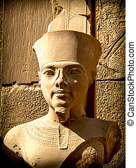 Bust of pharaoh Tutankhamun in Karnak Temple Luxor, Egypt -...