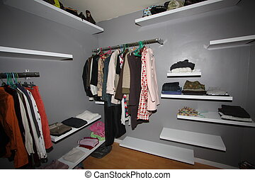 some clothes organized in a closet