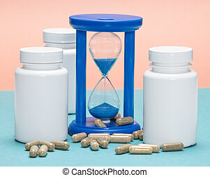 Anti-aging supplements concept: scattered capsules with...