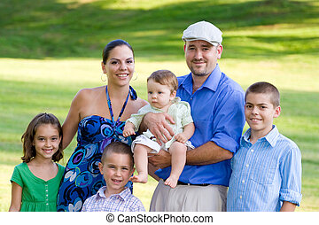 Happy Smiling Family - Portrait of an attractive young...