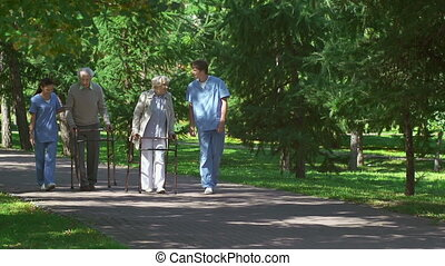 Elderly Patients - Two senior patients with walker...